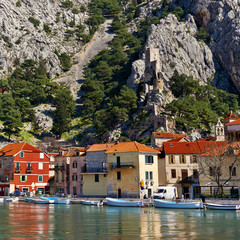 Beautiful old town of Omis with boats on the dock