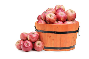 Studio shot of red apples in a wooden bucket