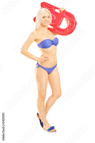Female in bikini holding a swimming float