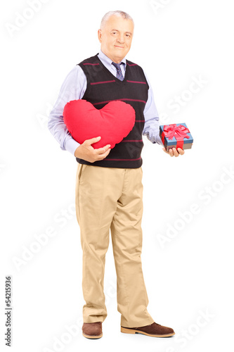 Mature gentleman holding a heart and gift