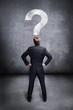 Geschäftsmann mit Fragezeichen