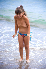 Little girl at tropical beach