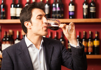 Sommelier tasting a glass of wine