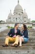 Couple kissing near the Sacre-Coeur in Paris