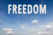 Freedom concept text in clouds