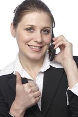 Businessfrau beim Telefonieren - Daumen hoch