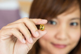 Women show the pill for healthy in horizontal