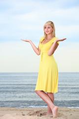Romantic Beautiful smiling girl yellow dress
