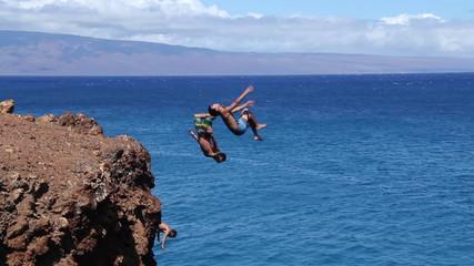 Three People Synchronized Backflips Into Ocean