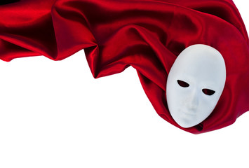 White mask on red silk fabric