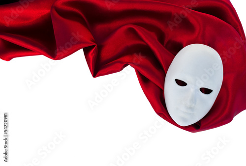Deurstickers Carnaval White mask on red silk fabric