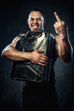 Man with metal fuel can showing middle finger