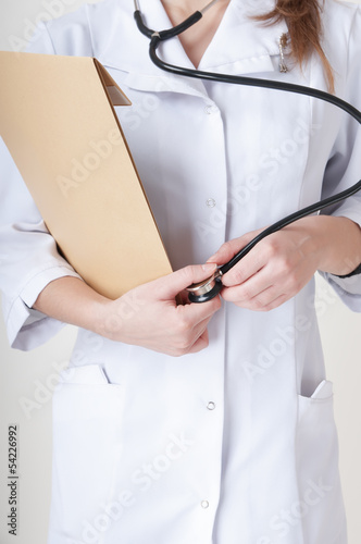 Nurse with a stethoscope isolated on white background.