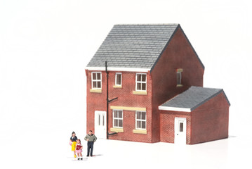 Family home concept with model house and people on white backgro