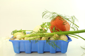 tomato mushroom herbs in container