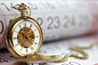 Gold pocket watch and calendar