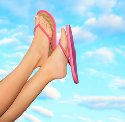 Female legs in pink sandals