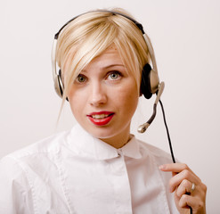 beauty blond woman with headphones, call operator