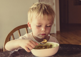 Boy Eating his breakfast Early in the Morning