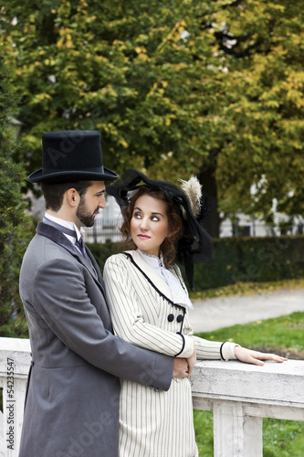 Old-fashioned dressed couple in the park in love