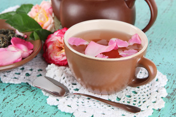 Kettle and cup of tea from tea rose