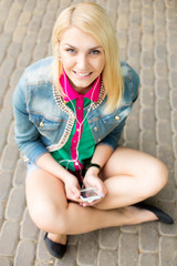 Young blond girl listening music