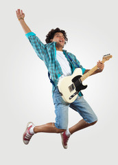 young man playing on electro guitar