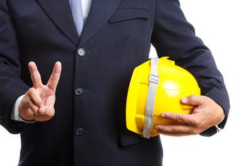 engineer holding helmet on white background