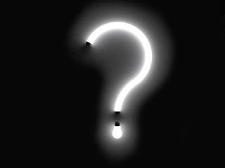 question mark fluorescent lamp on white background
