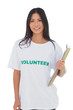 Woman wearing volunteer tshirt holding clipboard