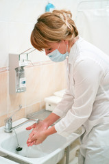 health occupation worker washing her hands