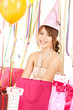 happy girl with color balloons and gift bags