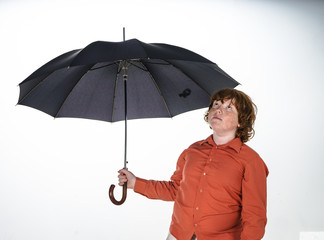 Freckled red-hair boy with umbrella.