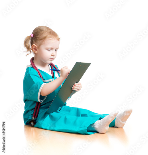 Child girl uniformed as doctor writing to clipboard isolated on