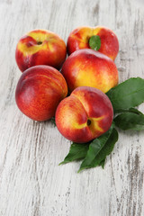 Peaches on wooden table