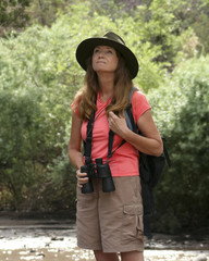 An Attractive Woman Birdwatching by a River