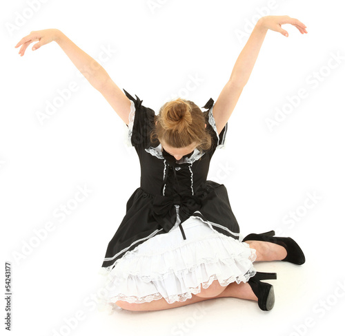 Caucasian Girl Child Sitting in Marionette Pose in Lolita Fashio