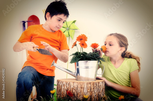 Child Couple Flower Garden Concept