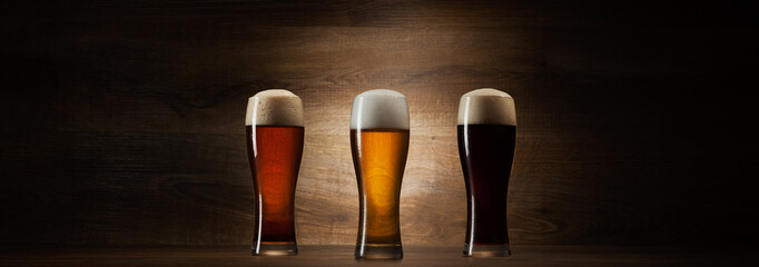 tree glass beer on wood background with copyspace