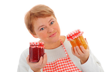 Woman cutting fruit and canning
