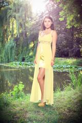Beautiful brunette at the chateau lake