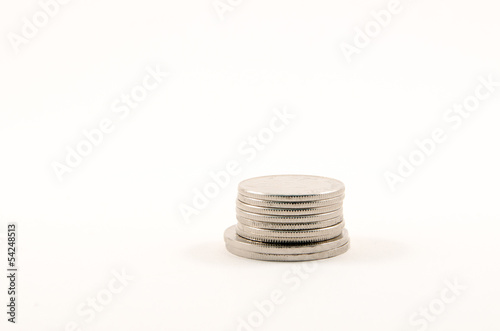 Silver coins stacked together in Canadian money