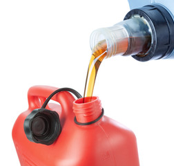 The engine oil is poured in a plastic canister. On a white backg