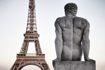 Paris France Eiffel Tower with Statue of Man Dusk Sky