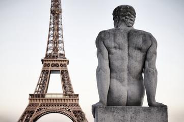 Paris France Eiffel Tower with Statue of Man Dusk Sky