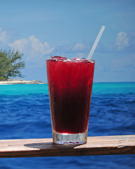 Rum punch or fruity drink in a tropical paradise