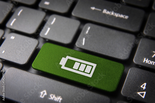 Green keyboard key battery status, technology background
