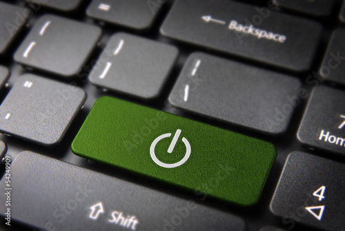 Green Power On keyboard key, technology background