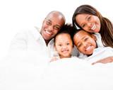 Loving family in bed