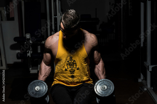 bodybuilder posing with dumbbells